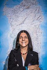 professor Antonella Sorace in front of Sardinia map